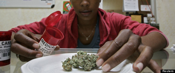 Union member Taylor displays medical marijuana during a media visit at the Venice Beach Care Center medical marijuana dispensary in Los Angeles, California