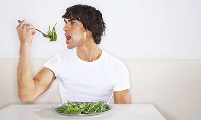 Man eating greens