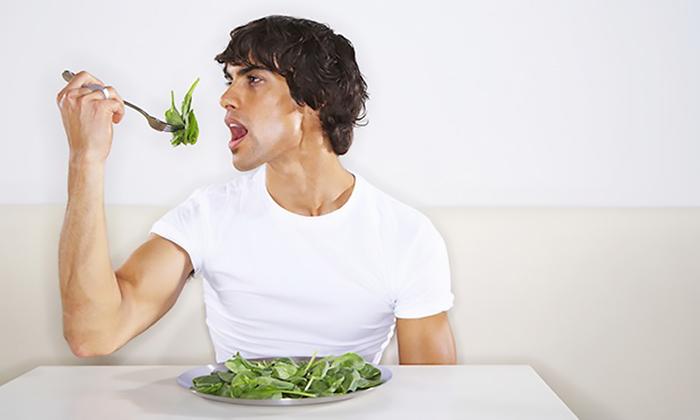 Man eating greens