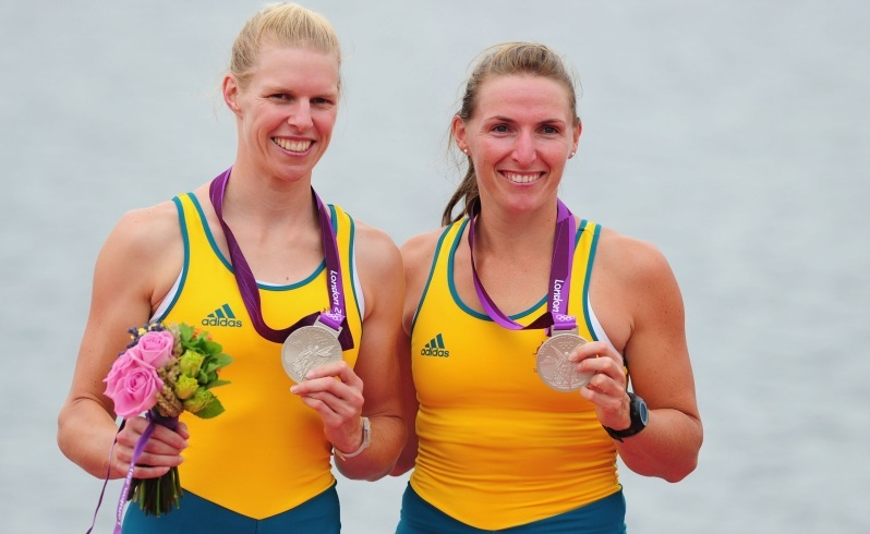WINDSOR, ENGLAND - AUGUST 01: Silver medallists Sarah Tait and Kate Hornsey of Australia celebrate with their medals after competing in the Women's Pair Final A on Day 5 of the London 2012 Olympic Games at Eton Dorney on August 1, 2012 in Windsor, England. (Photo by Mike Hewitt/Getty Images)