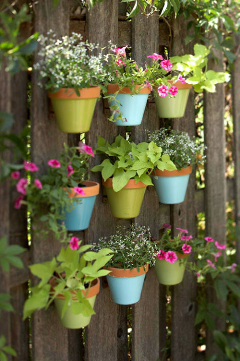 gallery-1430163754-colorful-pots-on-fence